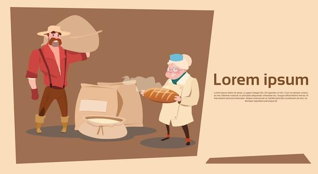 La famiglia degli agricoltori tiene il pane fresco di grano