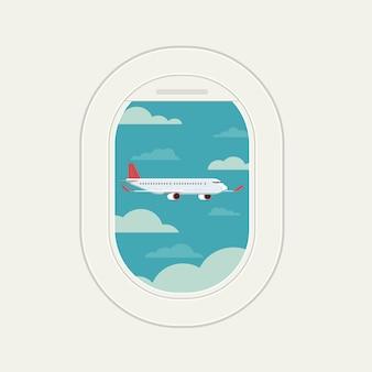 La finestra del piano di vista vede l'aereo volare al cielo di viaggio