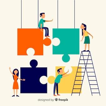 La gente che collega il puzzle collega il fondo variopinto