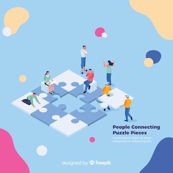 La gente che collega il puzzle collega la priorità bassa