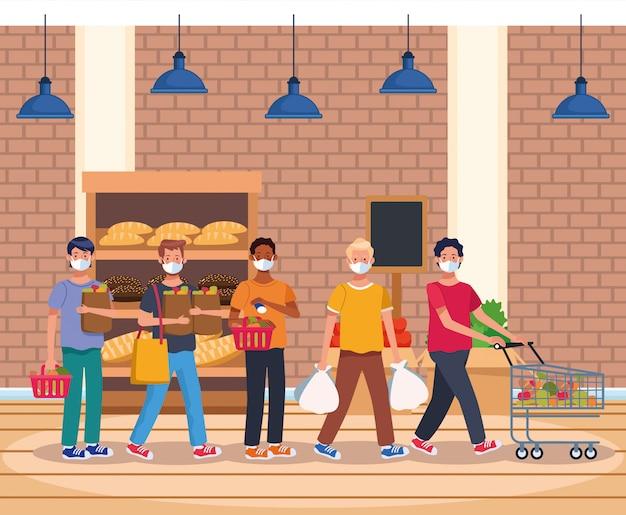 La gente che compera nel supermercato con la maschera