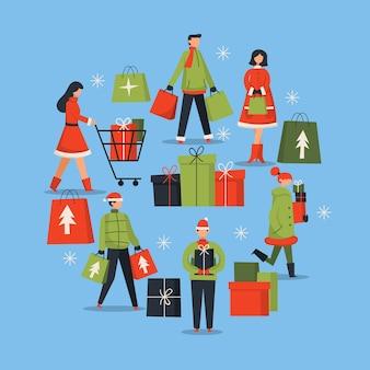 La gente che compra il pacchetto di regali di natale