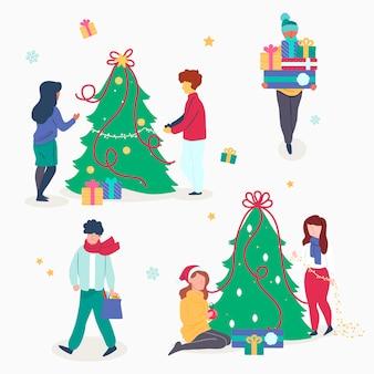 La gente che decora il pacchetto dell'albero di natale