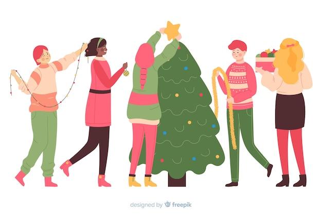 La gente che decora insieme l'albero di natale