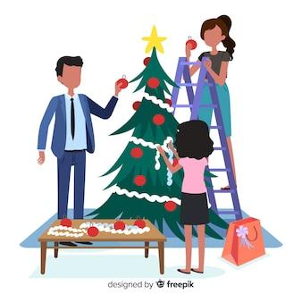 La gente che decora l'albero di natale