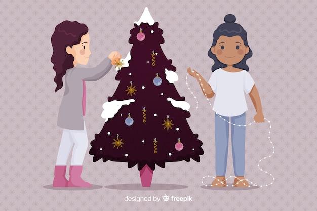 La gente che decora l'albero festivo