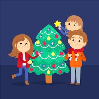 La gente che decora l'insieme dell'albero di natale