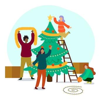 La gente che decora la collezione di alberi di natale