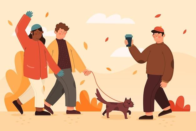 La gente nel concetto del parco di autunno