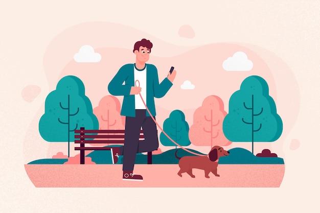 La gente porta a spasso il cane fuori
