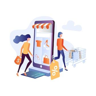 La giovane donna acquista online usando lo smartphone