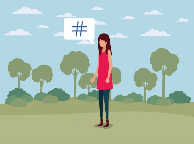 La giovane donna con la libbra digita la bolla di discorso sul campo