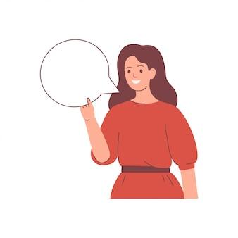 La giovane donna felice tiene un fumetto in bianco nella mano. concetto di presentazione.