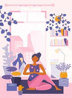 La giovane donna pratica la meditazione e lo yoga a casa. la persona nella stanza conduce allenamento e sport. trascorrere del tempo a casa. tempo libero in quarantena. spazio accogliente. città fuori dalla finestra. piatto .