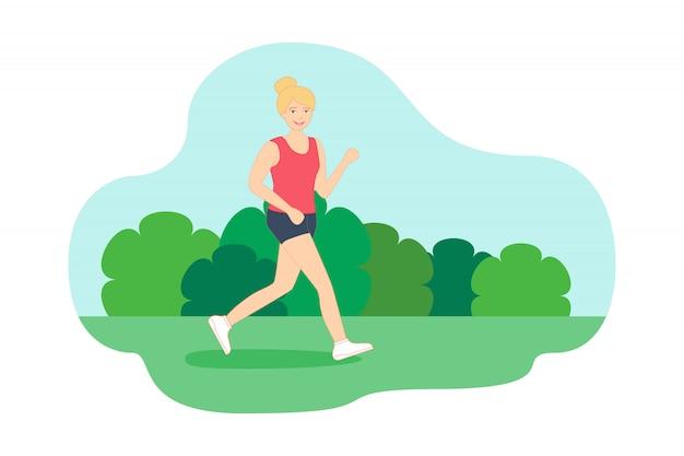 La giovane donna sta correndo nel parco