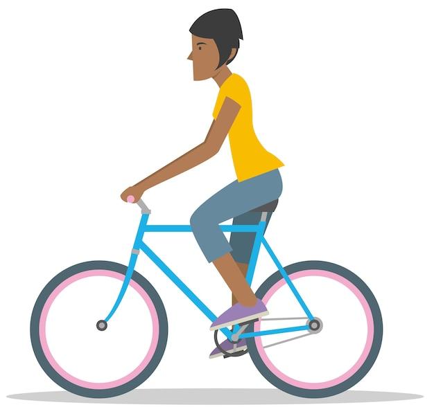 La giovane donna va in bicicletta