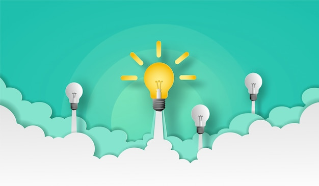 La lampadina e la squadra lanciano verso il cielo verde sopra la nuvola e fumano. disegno vettoriale nel taglio della carta.