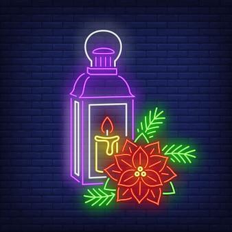 La lanterna con la candela e la stella di natale fioriscono l'insegna al neon