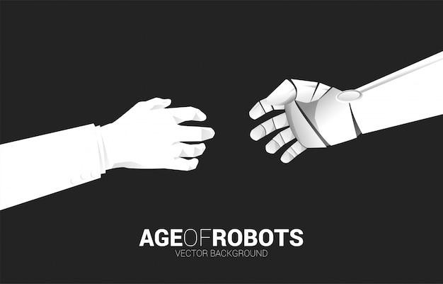 La mano del robot raggiunge per toccare con la mano umana