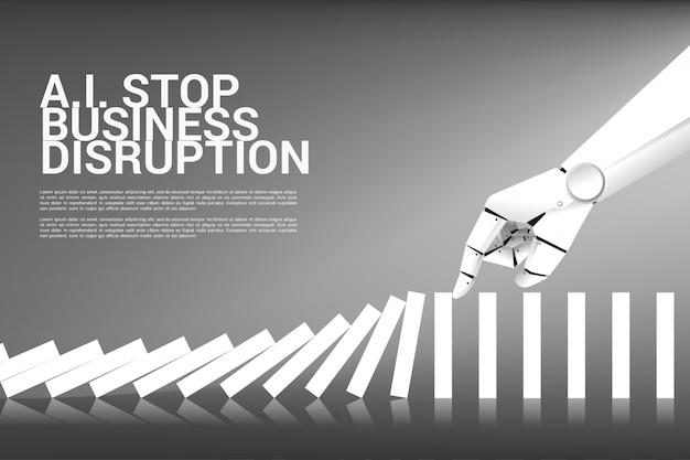 La mano del robot tenta di fermare l'effetto domino. concetto di business di interrompere l'interruzione