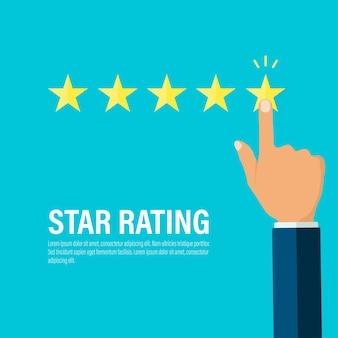 La mano dell'uomo d'affari dà e punta a cinque stelle d'oro per la valutazione e il feedback dall'abitudine