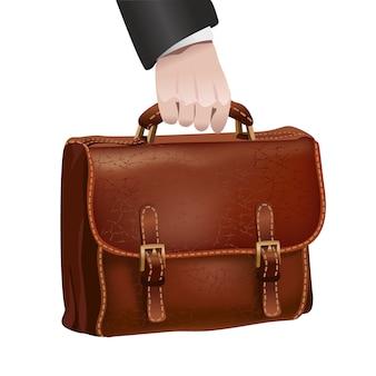 La mano dell'uomo d'affari tiene la cartella di cuoio