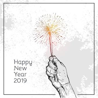 La mano della gente tiene i fuochi d'artificio di ustione