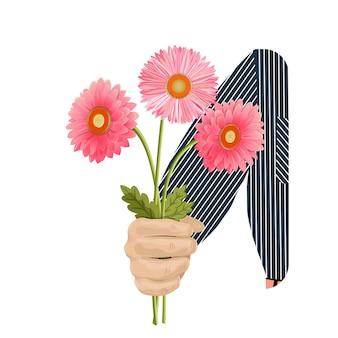 La mano di un uomo dà un bouquet con tre gerbere rosa