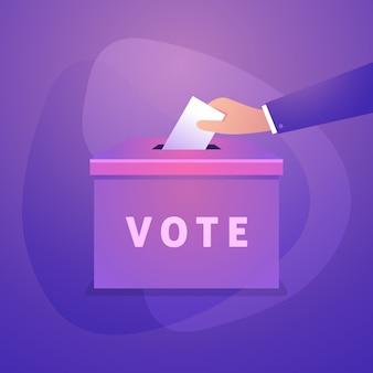 La mano mette il bollettino di voto nella scatola dei voti.