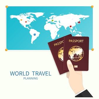 La mano tiene la mappa del mondo del passaporto