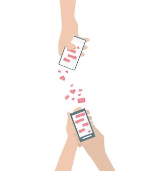 La mano umana sta inviando sms d'amore