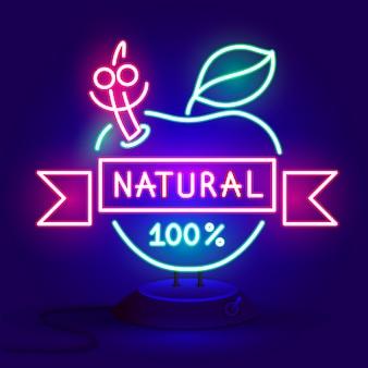 La mela naturale dell'insegna al neon emette luce nell'oscurità