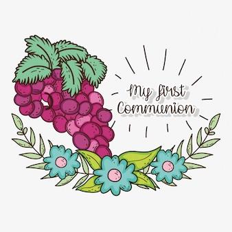 La mia prima comunione con grapers e fiori con foglie