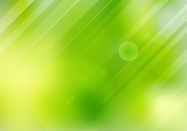 La natura verde astratta ha offuscato il fondo con illuminazione.