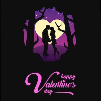 La notte una coppia bacia il giorno di san valentino all'aperto