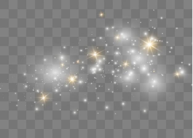 La polvere scintilla e le stelle dorate brillano di luce speciale. particelle di polvere magica scintillante.