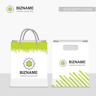 La progettazione delle borse di acquisto della società con il vettore di logo dell'ingranaggio