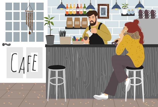 La ragazza beve il caffè in un bar e un barista