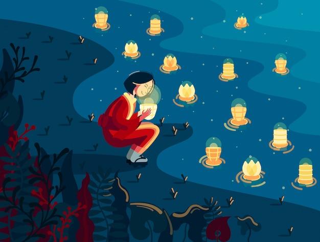 La ragazza giapponese in kimono tiene la lanterna luminosa vicino al fiume alla notte