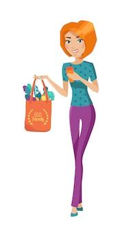 La ragazza sta tenendo la borsa eco con verdure e tazza riutilizzabile. concetto ecologico e zero sprechi.