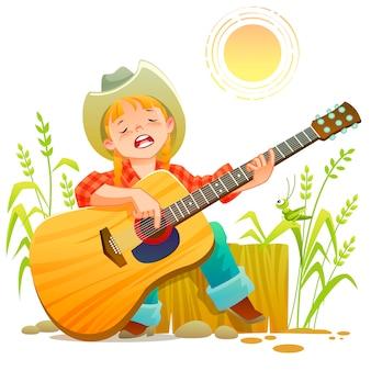 La ragazza teenager del paese sta suonando la chitarra e sta cantando