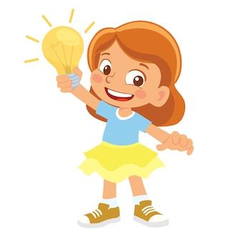 La ragazza tiene la lampada elettrica