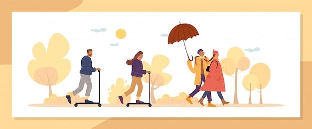 La stagione attiva dell'autunno la gente cammina nel parco naturale