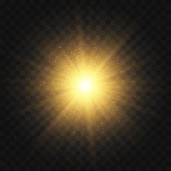 La stella è scoppiata di scintillii. set di luce gialla incandescente esplode su uno sfondo trasparente particelle di polvere magica scintillante. stella luminosa glitter oro. sole splendente trasparente, lampo luminoso