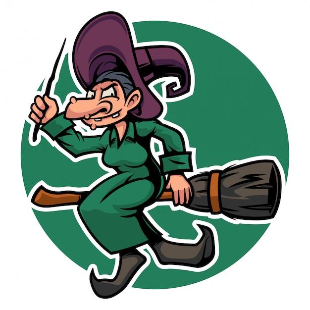 La strega divertente di halloween vola con la sua scopa e tiene la bacchetta magica