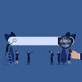La stretta della mano della barra di ricerca di affari si ingrandisce e il gruppo mette la barra di ingrandimento.