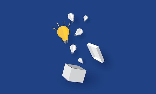 Lampadina incandescente galleggiante su una scatola di cartone, pensare fuori dagli schemi, concetto di business