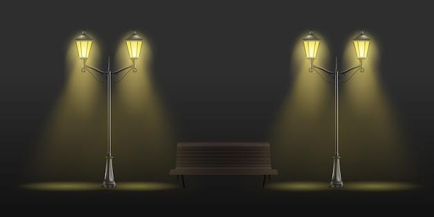 Lampioni stradali d'epoca incandescente con luce gialla e panca di legno