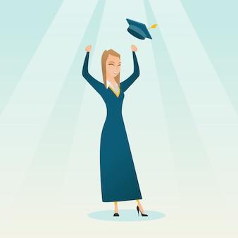 Laureato alzando il cappello di laurea.