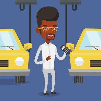 Lavoratore che controlla catena di montaggio automatizzata per l'automobile